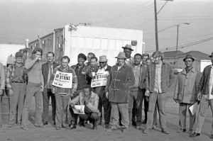 Striking steelworkers pose for group shot at Mineral Pigment in Beltsville, MD 1973. Note copy of Washington Area Spark in foreground.